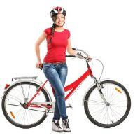 13293653 - full length portrait of a smiling female posing next to a bicycle isolated on white background